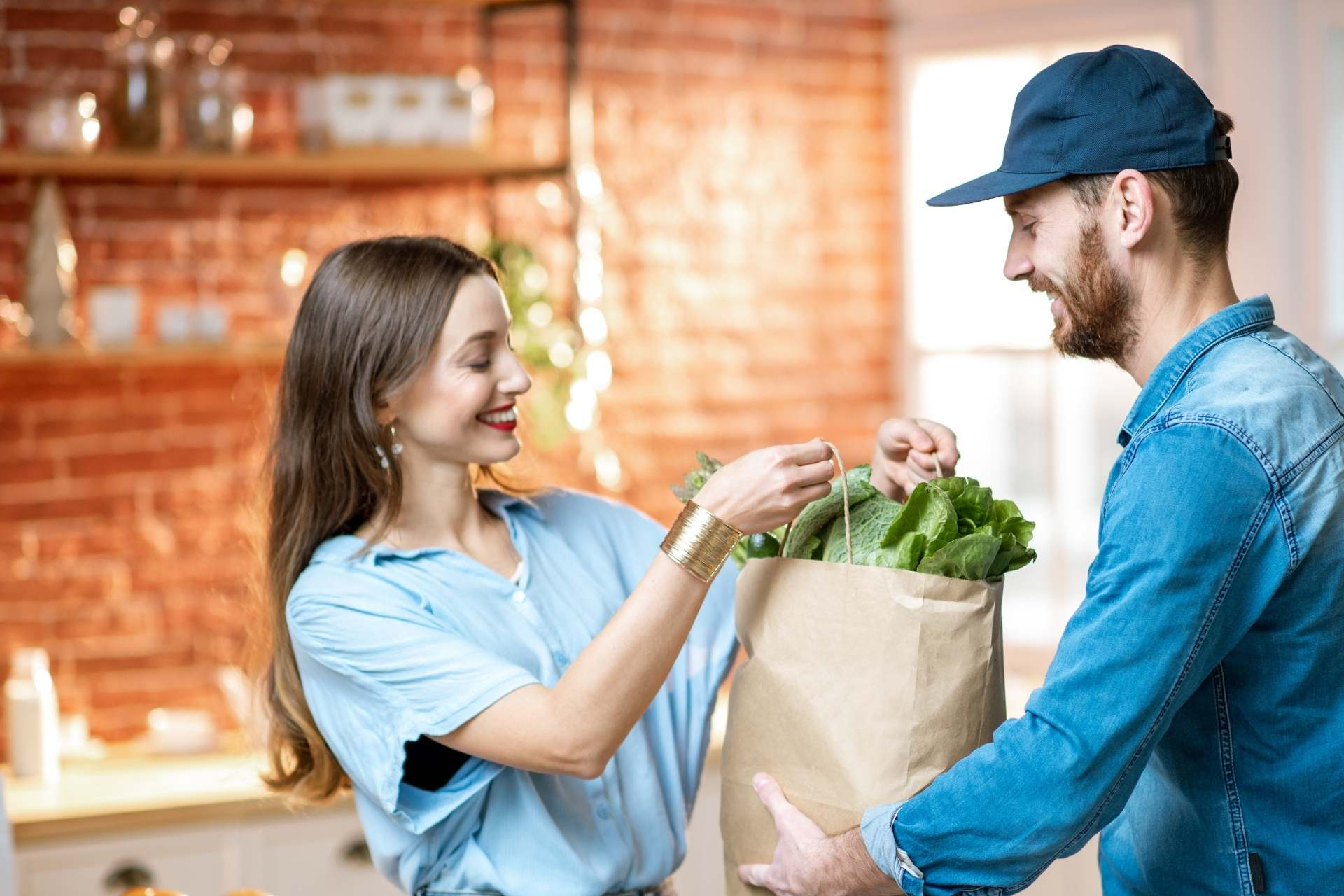 Delivery-man-arriving-to-an-household-with-groceries